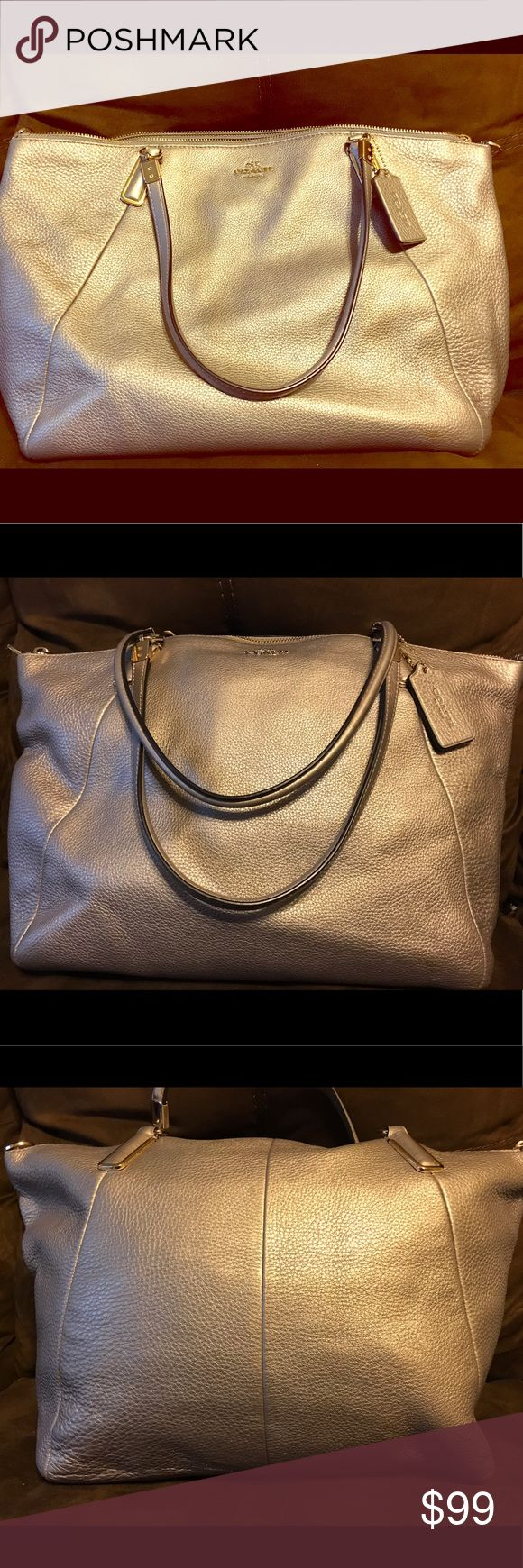 Metallic gold COACH shoulder bag Metallic gold COACH shoulder bag- comes with shoulder strap. Strap is still in tissue wrapping. Bag has been carried a few times- very gentle signs of use. Excellent condition!!! Coach Bags Shoulder Bags