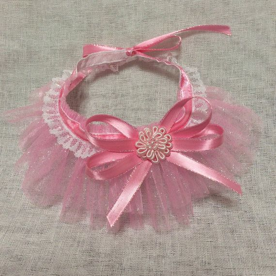 This adorable Ruffle Scarf is the perfect accessories for your fur baby, can be use for wedding, party, sweet sixteen, photo shoots, or any occasion. Made from premium Organza fabric with a little touch of glitter, and decorated with lace and satin ribbon. This item contains small parts, please do not leave your dog unsupervised went it wear the item.