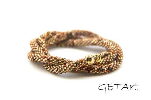 Koralik za koralikiem: Bransoletka potrójna brązowo - złota.