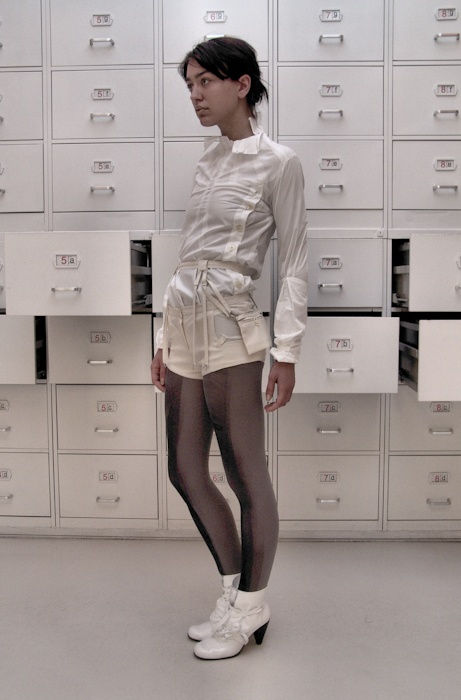 Shirt (cotton), shorts ( wool), belt (wool), tights (hand printed), shoes ( fake leather)