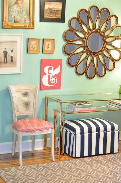 Mint, navy, coral. I like this bright, cheerful entry space!