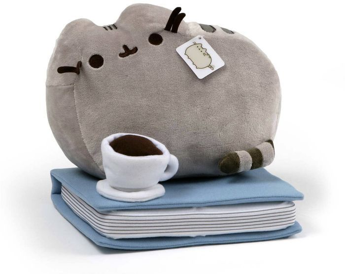 pusheen on a book with a coffee
