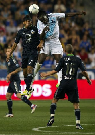 MLS All-Stars Carlos Valdes (2L) jumps for a header with Chelsea FC's Romelu Lukaku (2R) during the 2012 AT All-Star match at PPL Park in Philadelphia, Pennsylvania, July 25, 2012.  Major League Soccer hosts its midseason showcase match between the League's top players and the best of the world, this year taking on Chelsea FC of the English Premier League.
