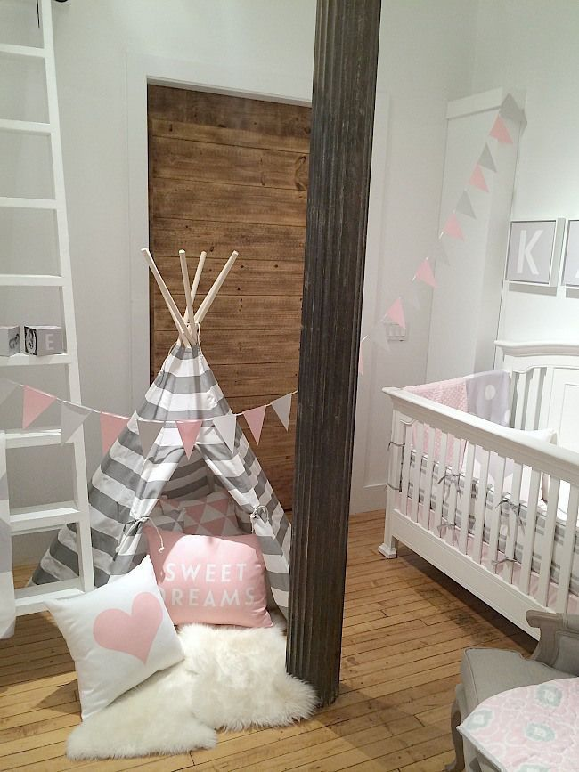 Pink, white, and gray teepee in a little girl's nursery