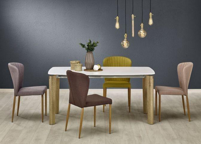 Krzesło K236 to niebanalne krzesło tapicerowane. Stelaż wykonany jest z metalu, czyniąc je solidnym i stabilnym, a siedzisko i oparcie pokryte jest przyjemną tkaniną, która sprawia, że krzesło jest miękkie i przede wszystkim wygodne.