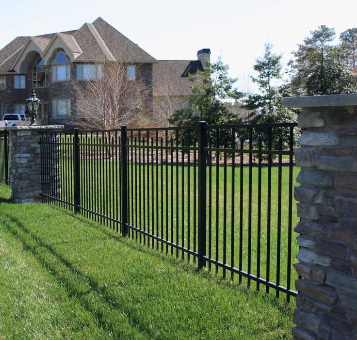 Stone Fence Pillars : Beautiful metal estate fencing with stone columns in