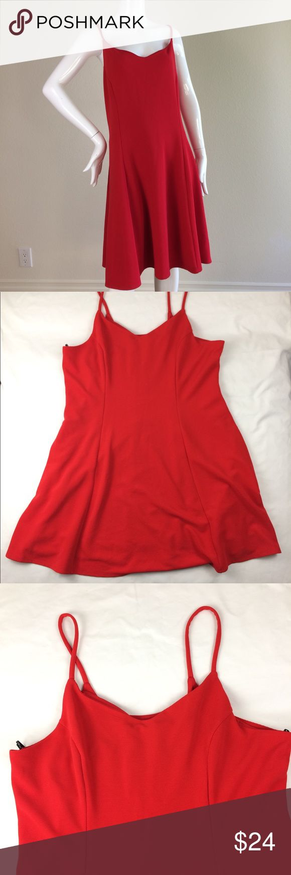 Red Holiday Dress - size 3XL Absolutely gorgeous and perfect for the Holidays. Like new. Forever 21 Plus dress, spaghetti straps, zipper in back, flare skirt.  MEASUREMENTS:  Length: 35 in (from top of dress) waist: 42 in bust: approx 47 in dress has approx 1-4 in stretch allowance.   K17007 Forever 21+ Dresses Midi