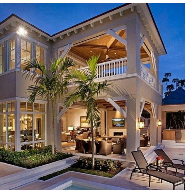 Railing staight, all white window molding, white rafter tails on roof