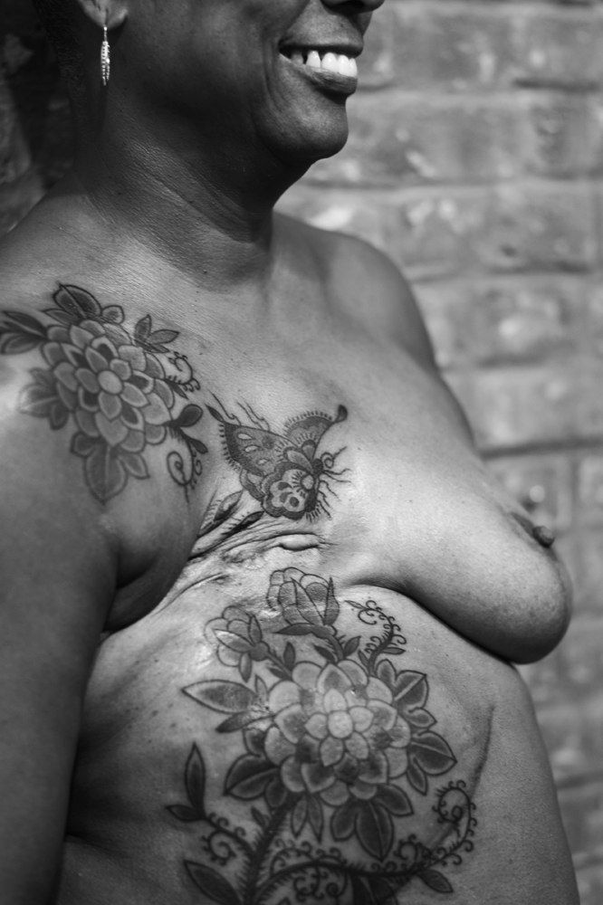 """""""It's an experience like no other, that I can honestly say but the absolutely amazing thing to me was...there's no pain after. How is that possible?"""" -- Pat, after Virgina Elwood designed and applied this beautiful post-mastectomy tattoo. Photo courtesy www.gigistoll.com / P.INK Day 2013 brought together 10 artists and 10 breast cancer survivors to heal with ink. Date: 10/21/13. [p-ink.org]"""