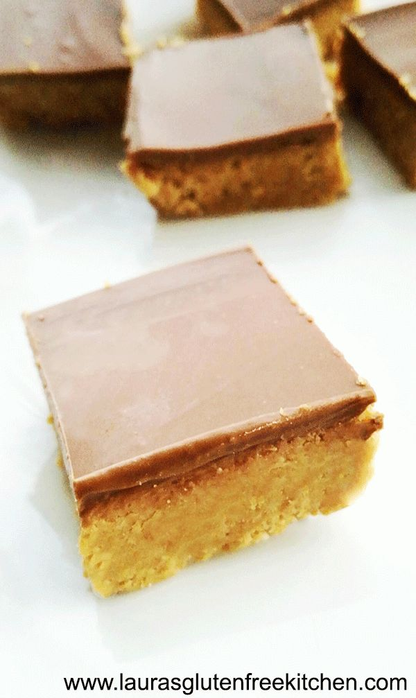 Gluten Free Peanut Butter Bars --- These Gluten Free Peanut Butter Bars are no bake, no mess, no fuss. I had these cooling in the fridge less than 10 minutes after I started making them.