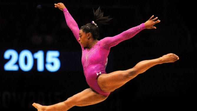 Perfect 10 as Simone Biles joins gymnastics greats | It was a perfect ten finish for Simone Biles at the world gymnastics championships on Sunday, November 1, 2015 as the young American became the most decorated woman gymnast of all time on the final day of competition.