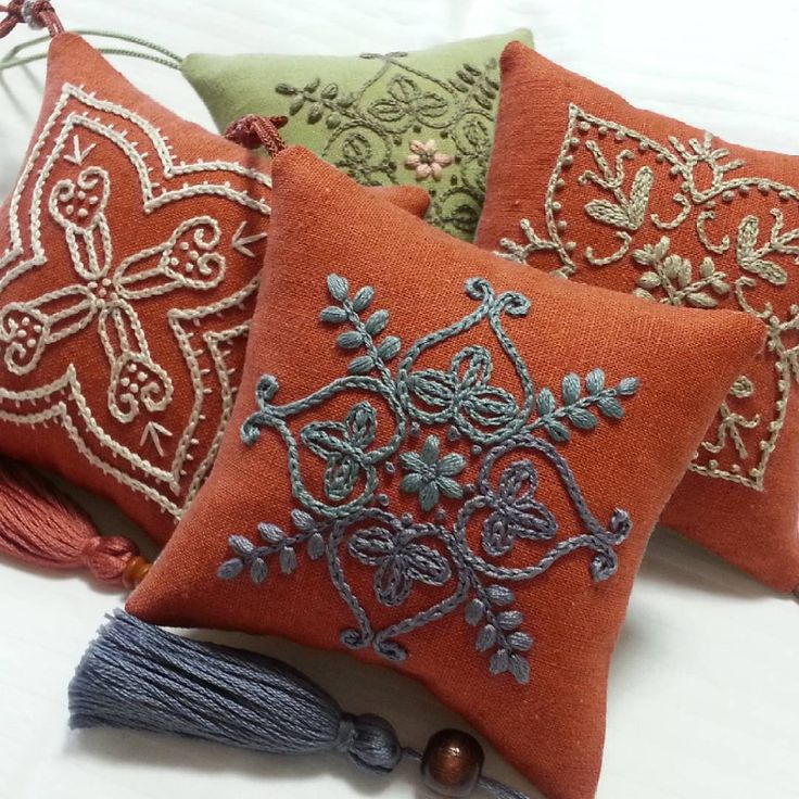 mini cushions with embroidery