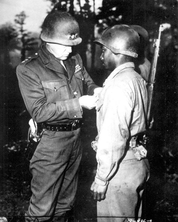 Lieutenant General Patton of the US 3rd Army awarding the Silver Star Medal to Private Ernest Jenkins for gallantry during actions at Chateaudun France 13 October 1944.