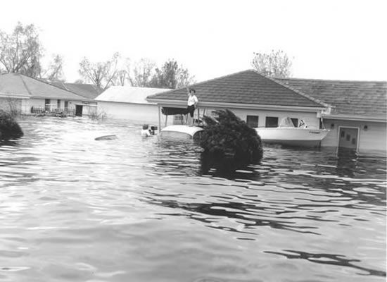 I was 16 when Hurricane Betsy paid a visit to Louisiana, coming right over Bayou Lafourche. This picture was taken in Chalmette.  http://chalmettecoc.org/images/betsy/betsy1.jpg