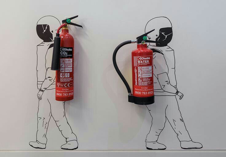 A creative way to store extinguishers on the wall...