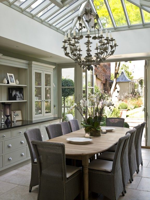 Soft grey green walls with dark grey accents modern country conservatory dining