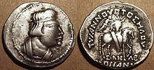 """The first self-declared Kushan ruler Heraios (1-30 CE) in Greco-Bactrian style.  Obv: Bust of Heraios, with Greek royal headband.  Rev: Horse-mounted King, crowned with a wreath by the Greek goddess of victory Nike. Greek legend: TVPANNOVOTOΣ HΛOV - ΣΛNΛB - KOÞÞANOY """"The Tyrant Heraios, Sanav (meaning unknown), of the Kushans""""."""