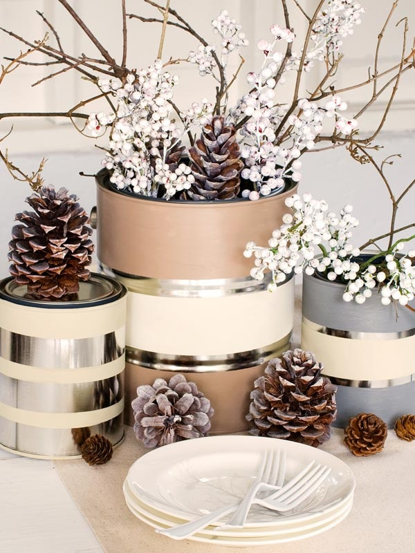 Winter Table Decorations:  Tape off sections of empty paint cans and apply paint in the colors of your choice. Fill with berries, pinecones, and twigs. (Lowe's Creative Ideas)