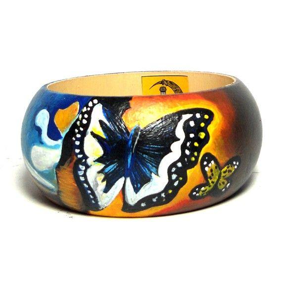 Br86 Bracciale in legno dipinto a mano Paesaggio con farfalle di Dalì  30.00€  Bracciale in legno dipinto a mano, PAESAGGIO CON FARFALLE, Salvador Dalì, in una interpretazione by Hanùl. Lucidatura finale. Diametro interno 6,5 cm e altezza 4,5 cm. I colori della creazione possono essere leggermente diverse da come appaiono in foto.