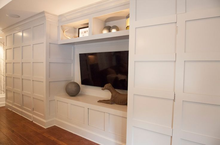 """could still do """"window seat"""" with TV concealed Lucy and Company: Incredible light gray wall to wall entertainment center with hidden doors for conceal…"""