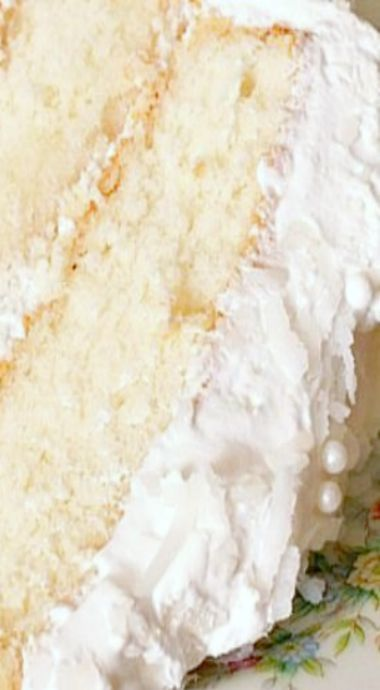 Lady Baltimore Cake - A soft, luscious white cake with a just a touch of lemon, filled with orange marmalade kissed with Grand Marnier. Mounds of sweetened coconut marshmallow frosting top this picture perfect special occasion dessert. ❊