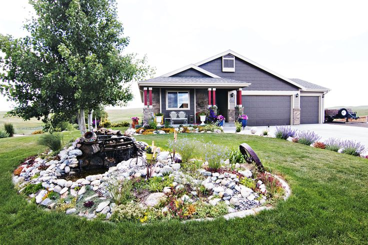 Gillette, WY home for sale! 302 Huntington Dr - 4 bd, 3 ba,3174 sqft. Amazing landscaping. Call Team Properties Group for your showing 307.685.8177
