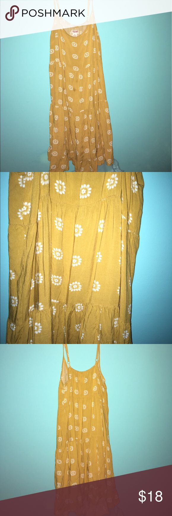 Yellow flowery dress This casual sun dress is one of my favorites! With a beautiful yellow color and flowery pattern, this makes a perfect outfit! Dresses