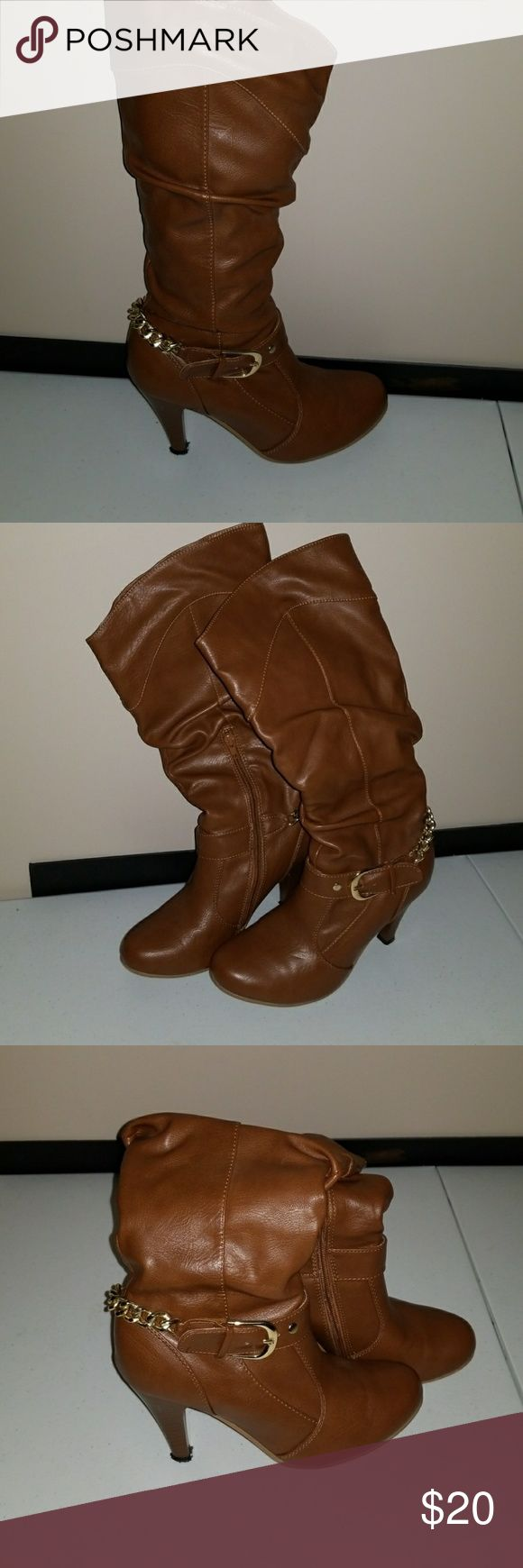 Cutest tan boots. Tan , almost knee high. Cute,  flirty paired with skinny jeans . Fit great on calves. Gold chain hardware. Inner calf half zipper. Short heel. Good used condition. Size 8 Shoes Heeled Boots