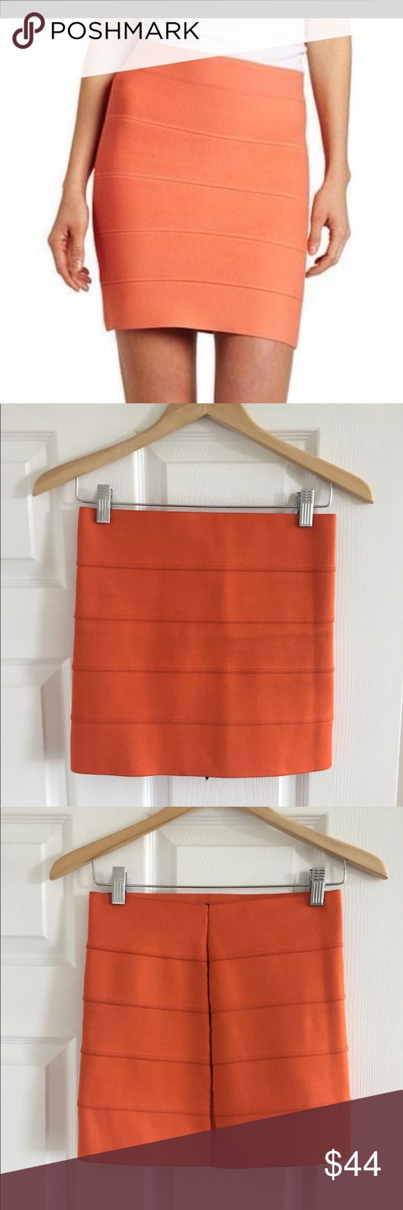 """Pleasure Doing Business 5 Band Orange Miniskirt This banded elastic skirt features seam details. Body hugging and sexy fit.   * 14"""" long. * Fabrication: Elastic. * 90% polyester/10% rubber. * Hand wash. * Made in the U.S.A. Pleasure Doing Business Skirts Mini"""