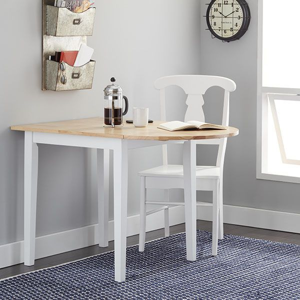 Capitalize space in your kitchen with help from this cozy drop-leaf country dining table. The small table accommodates two diners when the drops are down and three when it is risen. Its light wood fin