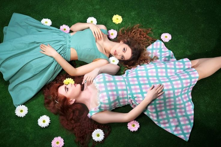 Talis pinafore top, button to a talis flared skirt and green and pink tartan print dress by Collectif