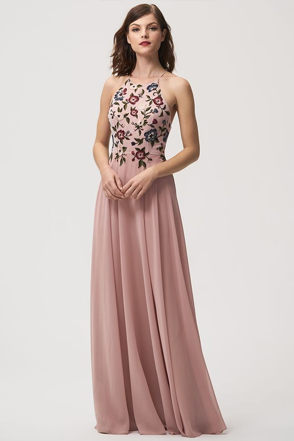 8624cb803 Jenny Yoo Bridesmaids, the Pink Sophie dress features a high halter  neckline that provides coverage and a dramatic spaghetti strap detail in  the open back.