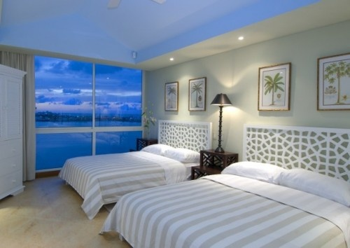 love that the ceiling reflects the water in the background, definitely a pretty vacation guest bedroom!