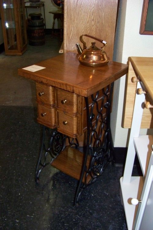 an upcycled singer treadle sewing machine stand they kept the four locking drawers the