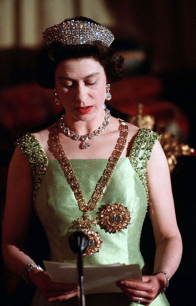 For the majority of her reign the keys to her wardrobe were jealously guarded by her dresser – and all-round gatekeeper - Margaret 'Bobo' MacDonald who worked for the Queen (pictured at the state banquet in Menelik Palace, Addis Ababa, during her visit to Ethiopia in February 1965) for an astonishing 67 years