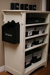 old dresser turned storage shelving unit