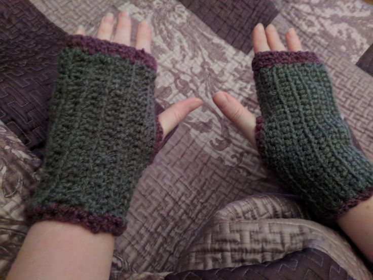 Grey crochet wrist warmers with purple edging