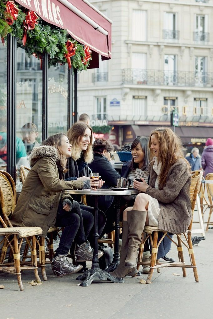This is a typical scene of friends enjoying coffee and conversation together! I wish I could see myself travel with a group of friends some day.