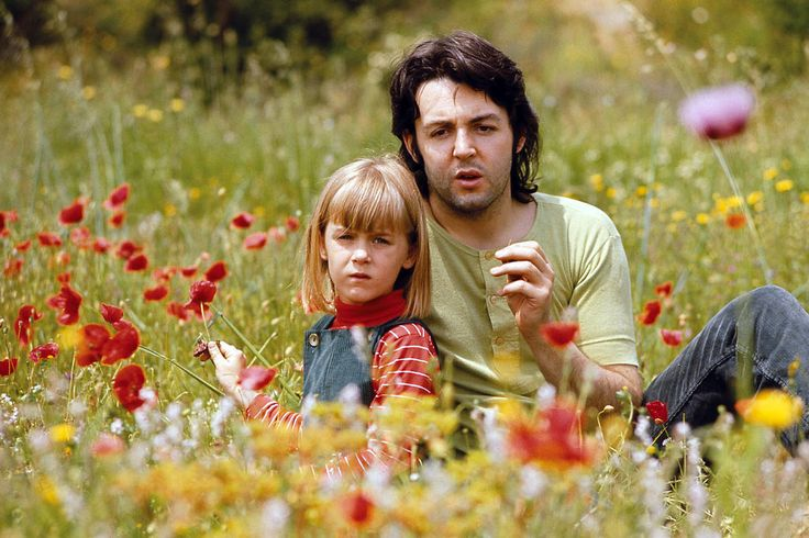 Heather McCartney, Paul McCartney and red flowers by Linda McCartney.