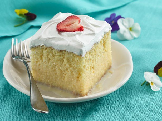 """Three forms of leche, or """"milk,"""" are poured over a baked cake to create its signature indulgence. Cake mix and ready-to-spread frosting make it easy."""
