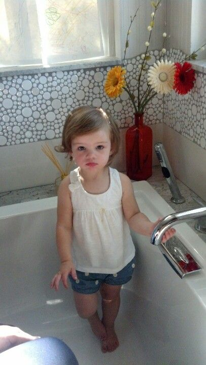 Master bath...with baby girl! Cute hair cut for little girl.
