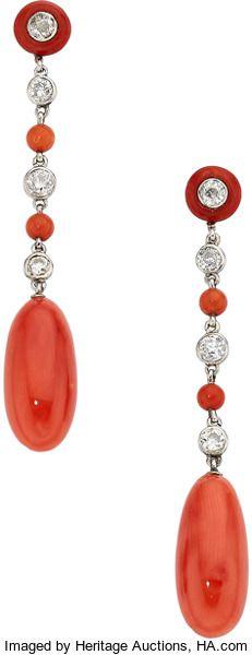 Estate Jewelry:Earrings, Coral, Diamond, Platinum Earrings The earrings...