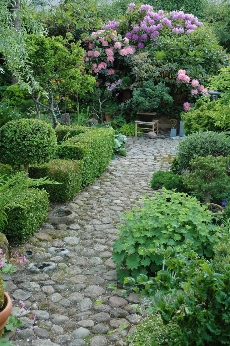 I think we should end one of the garden paths like this with rhododendrons.