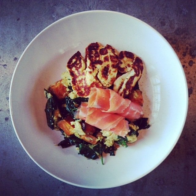 Sweet potato and kale scrambled eggs with halloumi and smoked salmon.