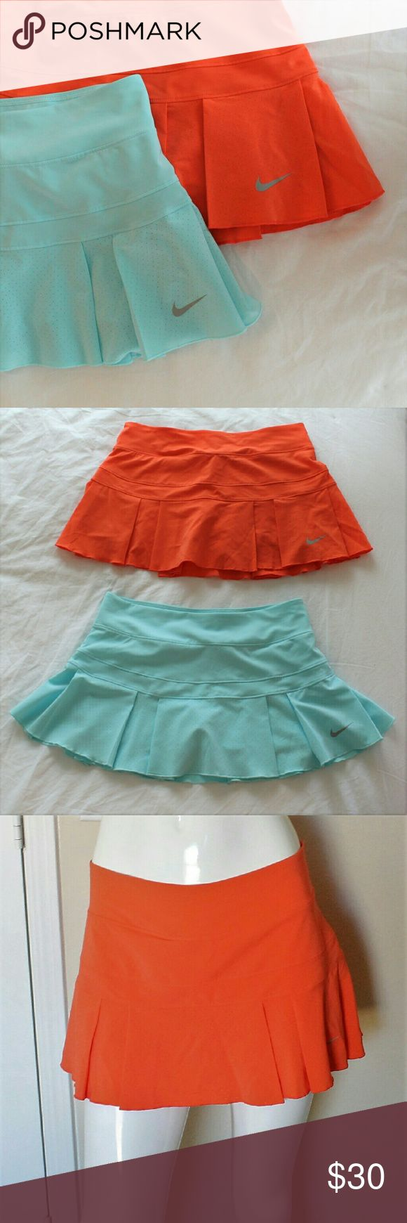 Nike Drifit Skort Bundle Two coral and light blue Nike Drifit skorts in like new condition. Each pair has an elastic waist and hidden short underneath. They are both the exact same size and style. These would be a perfect addition to any workout wardrobe.   Please let me know if you have questions or need more pictures. I will consider all reasonable offers, but no trades, please. Nike Skirts Mini