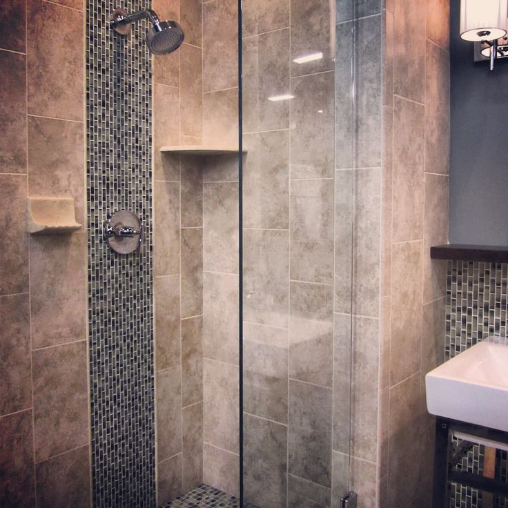 A glass mosaic stripe adds a nice touch of design to a shower.
