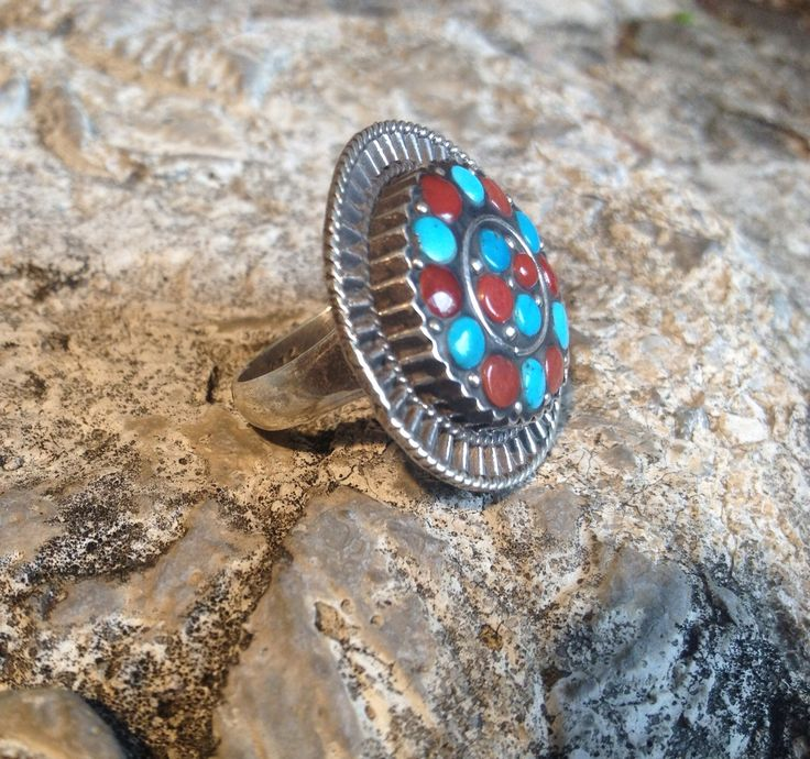 NAJIB JEWELLERS OFFERS CUSTOMERS A WIDE SELECTION OF SILVER JEWELLERY, ANTIQUE JEWELLERY AND BEADS FROM AROUND THE WORLD.   THIS IS OUR ONE OF A KIND STERLING SILVER CORAL & TURQUOISE    RING  WE ONLY SELL ON ETSY PLEASE CLICK THE LINK TO SEE MORE OF OUR PIECES  https://www.etsy.com/ca/shop/NajibJewellers/about?ref=shopinfo_about_leftnav  We ship world wide we do custom orders as well as whole sale   LIKE OUR FACEBOOK PAGE > NAJIB JEWELLERS<  FOR EXCLUSIVE PROMOS AND PRODUCTS