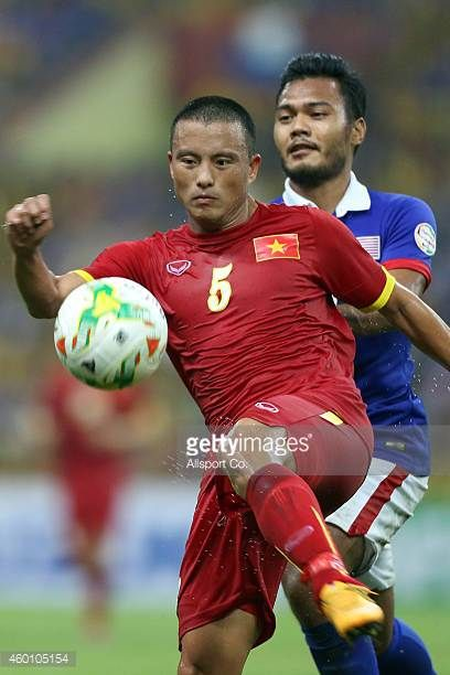 Nguyen Van Bien of Vietnam battles with Safee Sali of Malaysia during the 2014 AFF Suzuki Cup semi final 1st leg match between Malaysia and Vietnam...