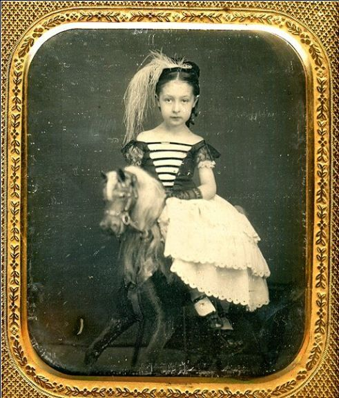 1850's, [portrait of a young girl on a rocking horse]