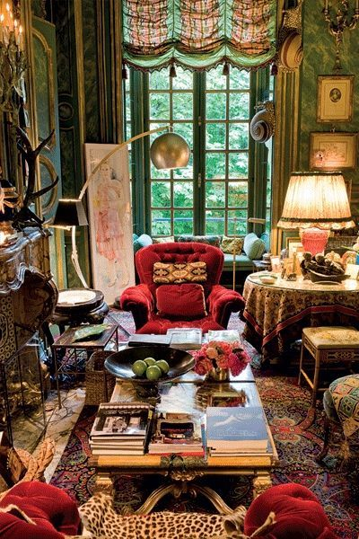 Hubert & Isabelle d'Ornano flat in Paris - Interior Design Henri Samuel So much to like about this. Perfectly cluttered. Red, green, leopard and other subtle colors in the valance offset with a mod chrome lamp!!